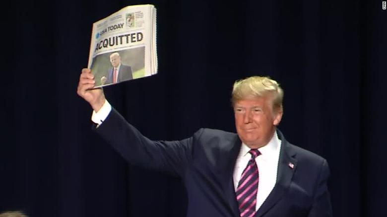 Trump holding paper impeachment